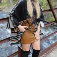 cape camel skirt otk boots styled by kasey