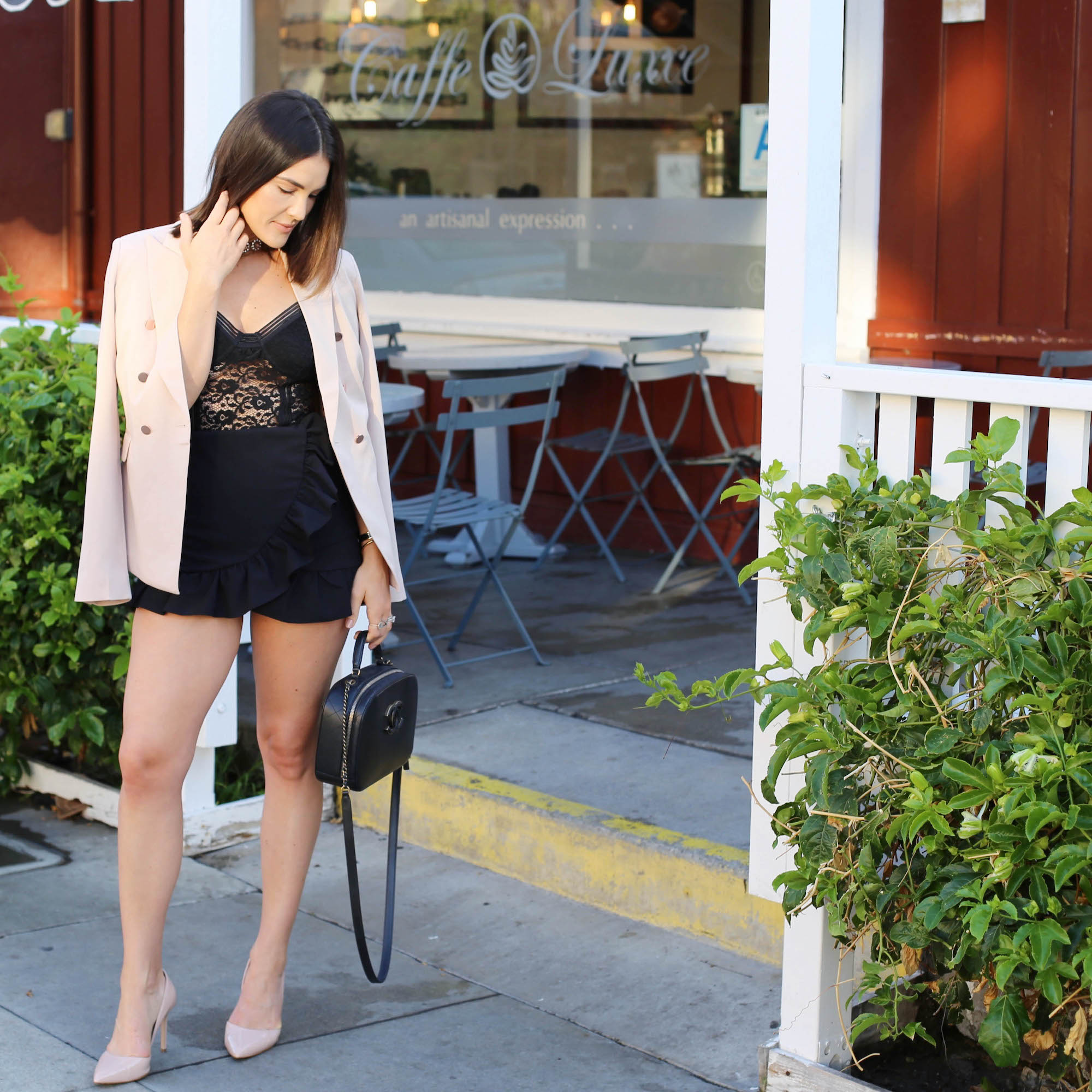 blush blazer and black outfit