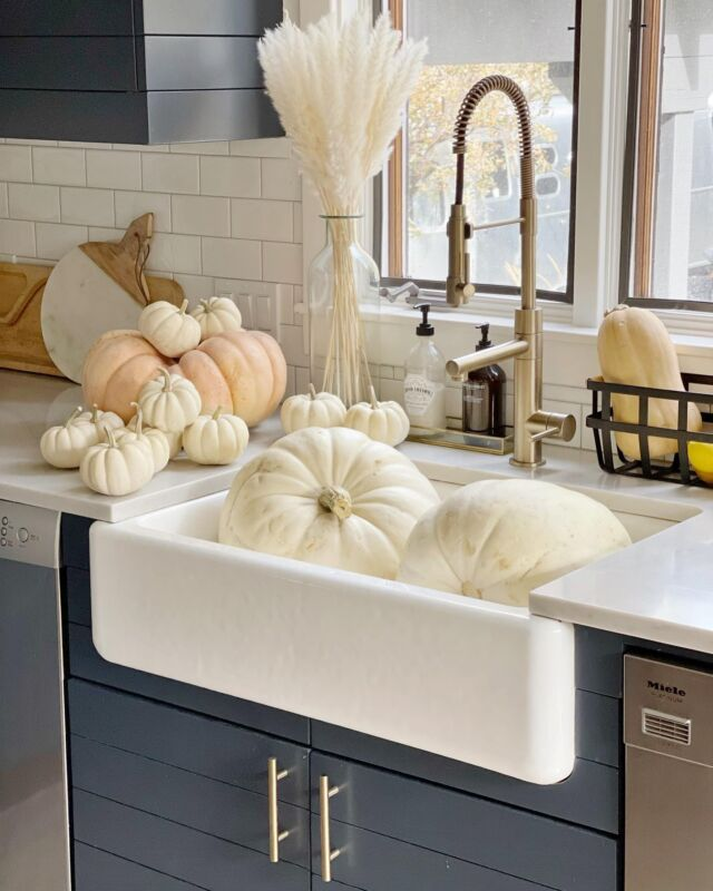 """F A L L \ well hello, pumpkins… and insta fam👋🏻 We gave our new beauties a little wash down today! Ford and I picked them from the farm this past week🍂 His new fave activity is standing at the sink """"cleaning"""" dishes so there was no problem getting him to help!😜 Happy to be back with y'all! Make sure to check out stories tonight for a fall inspired dinn dinn👩🏻🍳🍁  #fall #falldecor #pumpkins #kitchen #kitchendecor #farmhousesink #liketkit #LTKSeasonal  http://liketk.it/3p2iM"""