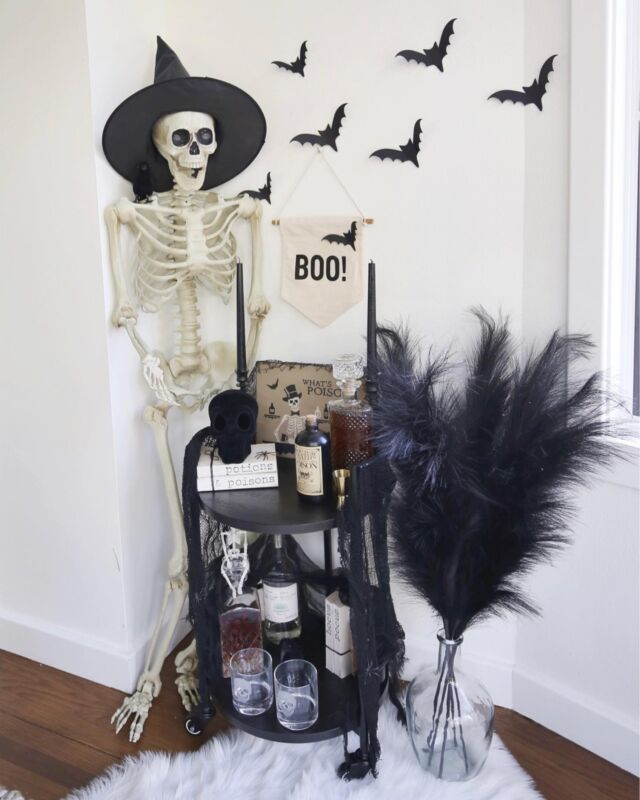H O M E \ BOO-zy bar💀 It's 5 o'clock and time for a cocktail! What's your poison?🍸   Sharing this festive Halloween bar on sbkliving.com🧙🏻♀️ New decor additions this year include: skull glasses, velvet skull and BOO-tiful black faux pampas grass!!🖤🖤🖤 LOVE all the texture!! Details and links over on the blog - click the link in my bio OR stories! Cheers!🥂🍷🍾  #bar #halloween #haloweendecor #skull #skeleton #homedecor #ltkhome  @shop.ltk http://liketk.it/3pmdF