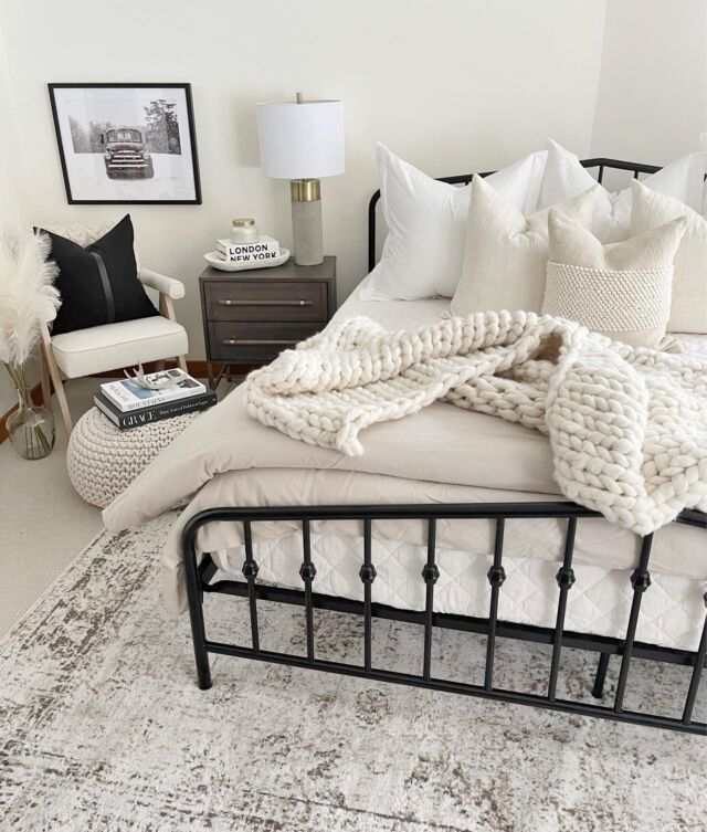 """H O M E \ Guest bedroom refresh👌🏻 Neutral bedding paired with a cozy corner😍😍 West & Ford """"helped"""" me style/make the bed today… it took about an hour🤣 Showing a closer look on stories!  Sharing a before & after of this space on the blog later this month… it 'twas rough😵 Shop this room now over on the LTK app! Click the link in my bio🙋🏻♀️ Nighty, night boo😴  #bedroom #bedding #homedecor #bedroomdecor #cozyhome"""